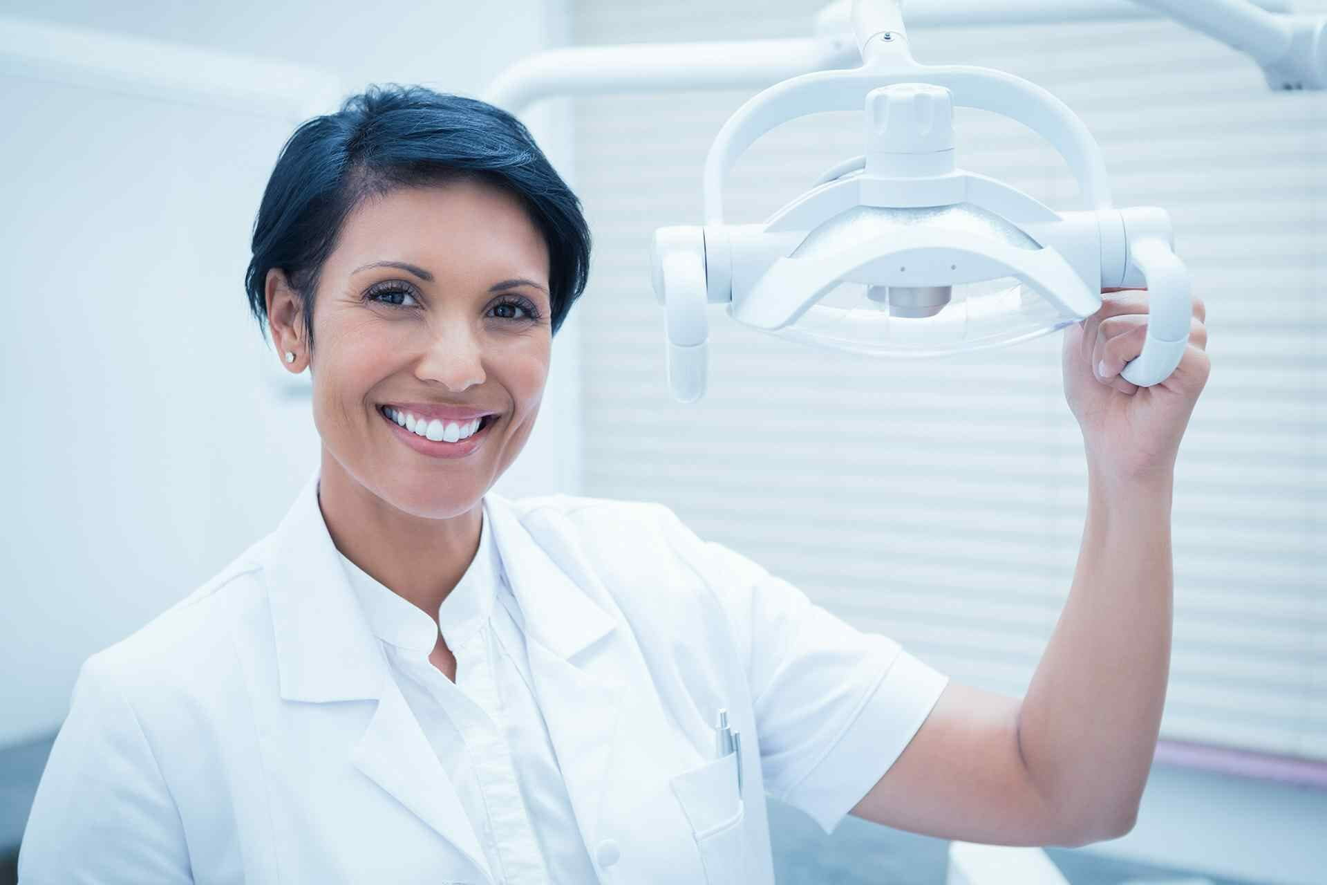 Dentist holding a dental lamp