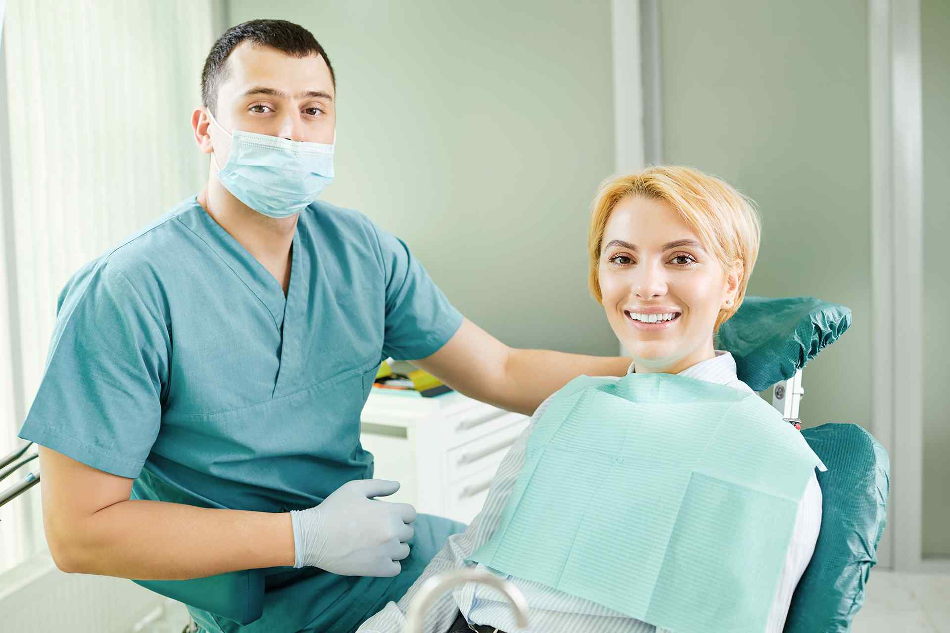 Woman and dental hygienist wearing a face mask